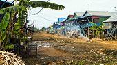 Poor Cambodian Poor Fishing Village On Tonle Sap, Cambodia poster