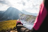 Adventurous Girl Navigating In With A Topographic Map In The Beautiful Mountains Of The Austrian Alp poster