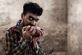Scary Bloody Zombie Man Eating Raw Meat poster