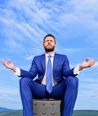Businessman Formal Suit Sit On Briefcase And Meditating Outdoors. Man Try To Keep His Mind Clear. Re poster