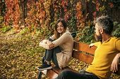 Love Relationship And Romance. Man And Woman With Yellow Tree Leaves. Autumn Happy Couple Of Girl An poster