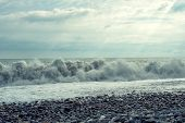 An Uneasy Black Sea With Waves And Foam. View From The Shore, Tinting. Sea Waves With A Lot Of Sea F poster
