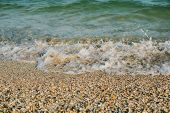 Sea Waves Washed Clean Beach Made Of Shells poster