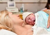 Mom And Newborn Baby Skin To The Skin After Birth In The Hospital poster