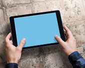 Man working with a digital tablet PC. Above view. Clipping path poster