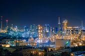 Oil And Gas Refinery Industry Plant With Glitter Lighting, Factory Of Petroleum Industrial At Night  poster