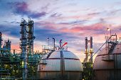 Petrochemical Plant On Sunset Sky Background With Gas Storage Sphere Tanks, Manufacturing Of Petrole poster