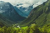 Scenic Norwegian Landscape. Mountain Valley With Glaciers On A Horizon. poster