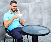 Coffee Break Brings Physical And Mental Wellbeing. Man Sit Terrace And Drink Cappuccino Speak Phone  poster