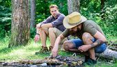 Masculinity Concept. How To Build Bonfire Outdoors. Men On Vacation. Man Brutal Bearded Hipster Prep poster