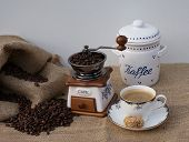 Close Up With Coffee Grinder, Cup With Coffee, Porcelain Coffee Tin, Coffee Sack With Coffee Beans poster