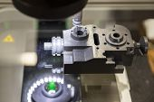 Industrial Machine That Shapes Precisely Metal Elements And Tools.automatic Industrial Machinery Equ poster