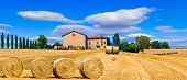 Beautiful countryside landscape with hay rolls and farm houses in Tuscany, Italy poster
