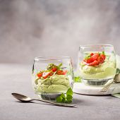 Fresh Guacamole Sauce From Raw Avocado With Cherry Tomatoes In Glasses. Healthy Vegetarian Food Conc poster