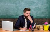 Paperwork Part Of Teachers Life. Check Homework. Teacher Bearded Hipster With Eyeglasses Sit In Clas poster