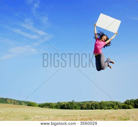 Girl Jumping With Sign