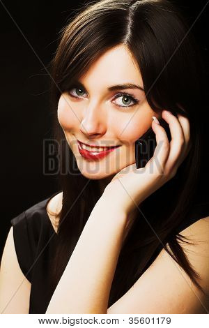 beautiful girl talking on the phone over black