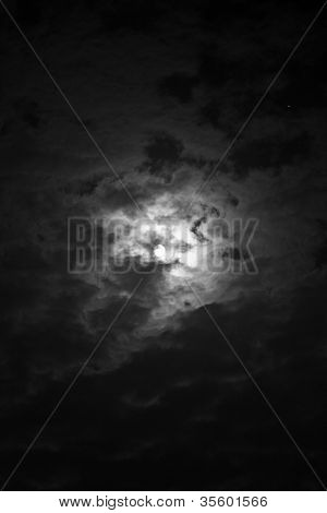 Full Moon and Star through the Clouds