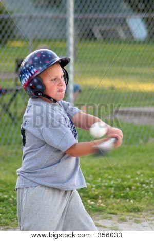 Boy Batting Baseball