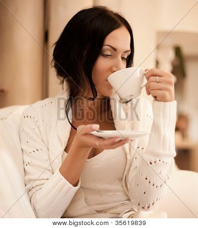 An attractive beautiful female holding a mug of coffee