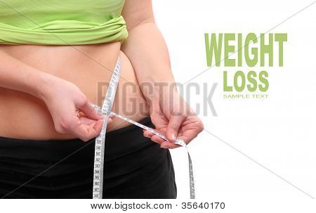 Close up of a overweight woman measure her waist belly by metre-stick.