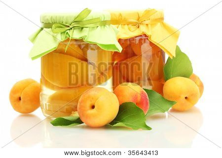 canned apricots in a jars and sweet apricots isolated on white