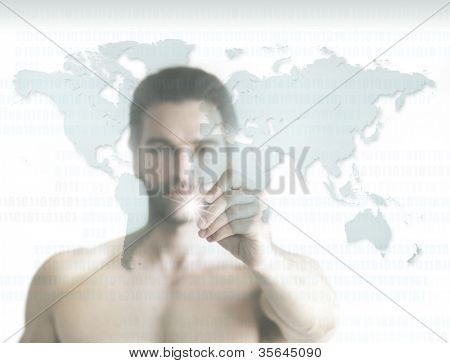 Business concept of a shirtless young man pointing to world map on transparent screen