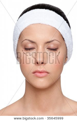 Young woman wants to make a facelift, closed eyes, isolated, white background