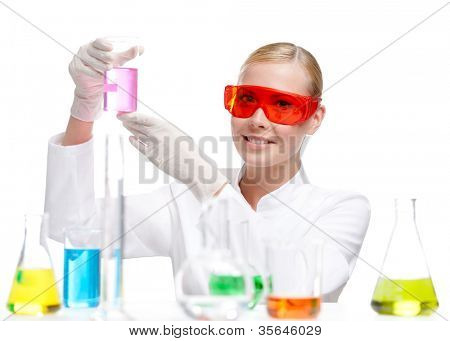 Pretty doctor in gloves keeps a beaker, isolated on white