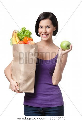Pretty young woman with the packet full of different healthy food, isolated, white background - diet concept