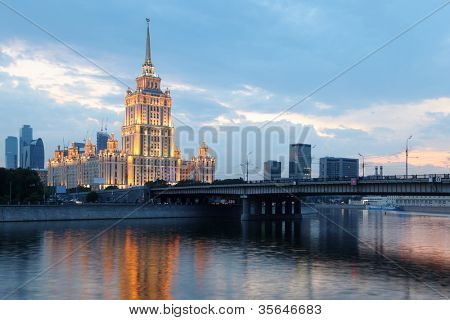 Novoarbatsky bridge and Hotel Ukraine - one of seven Stalinist skyscrapers at night, Moscow, Russia.