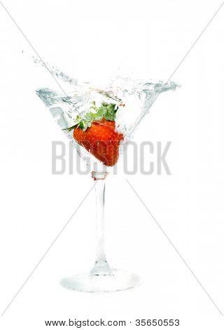 splashing strawberry into a martini glass