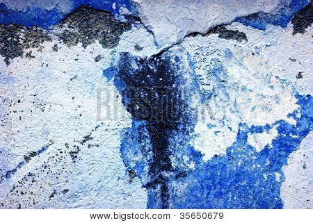 Old brickwall falling apart, rough texture closeup