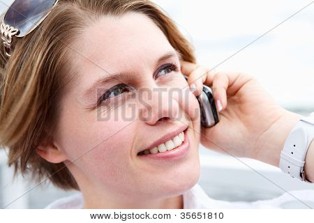 Happy Woman With Sunglasses Calling On Mobile Telephone. Close Up