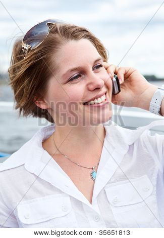 Happy Woman In White Shirt With Sunglasses Calling On Mobile Telephone.