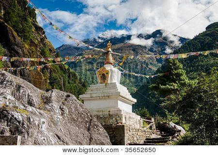 Buddhism: Stupe Or Chorten With Prayer Flags In Himalayas