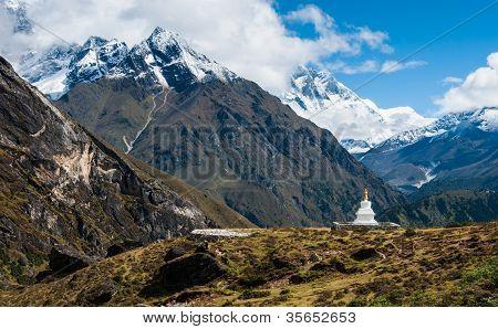 Buddhist Stupe Or Chorten And Lhotse Peaks In Himalayas