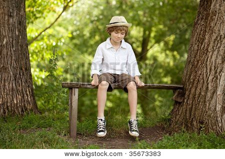 Fair-haired Boy In A Hat, Shirt, Shorts