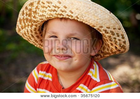 Smiling Boy In A Wicker Hat