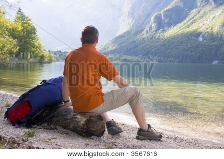 Hiker Relaxing At A Mountain Lake