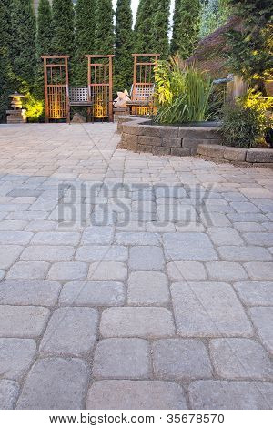 Paver Patio With Garden Decoration And Landscape Lights