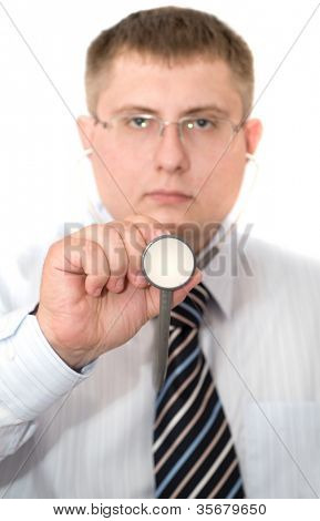 male doctor holding up a stethoscope