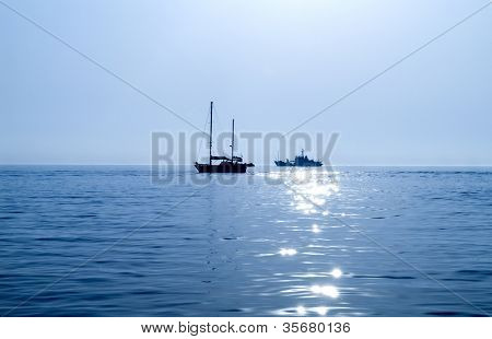 The ship on the sea in the evening