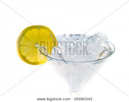 Martini with a lemon. Isolation on white