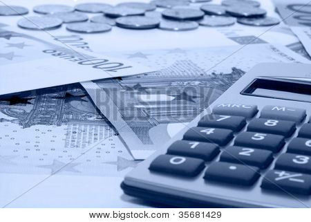 Business accessories. Money and  calculator.