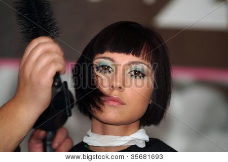 Work of the hairdresser(barber) with model