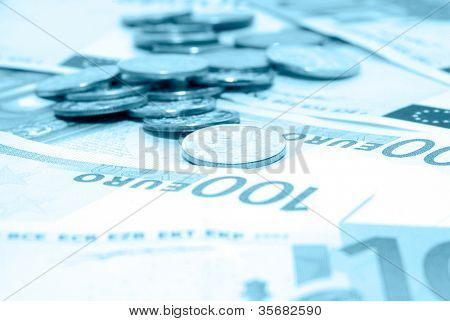 Banknotes of euro and coin.
