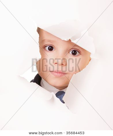 Serious Kid Looks Through A Hole In Paper