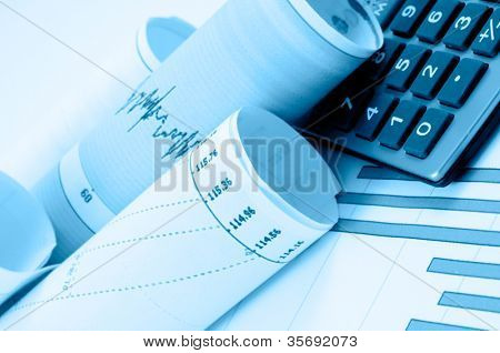 Business accessories on a background of diagrams