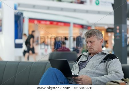 male traveler with the laptop